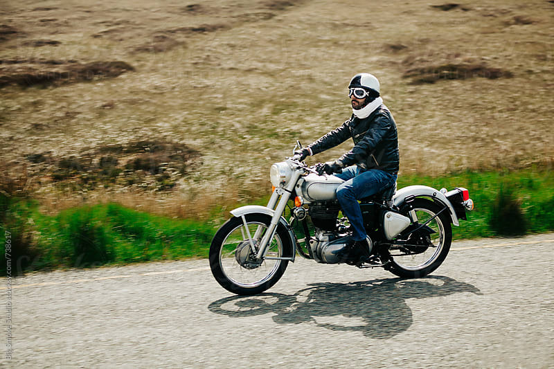 Biker on a motorbike. by Big Smoke Studio for Stocksy United