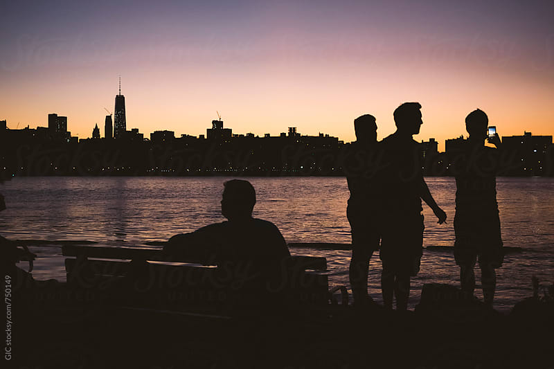 People watching sunset on Manhattan NYC by Simone Becchetti for Stocksy United