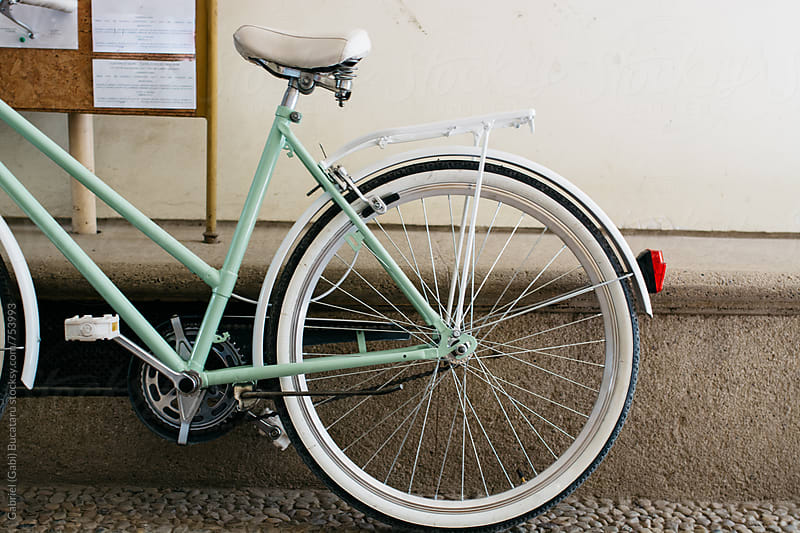 Vintage turquoise bicycle parked by a wall by Gabriel (Gabi) Bucataru for Stocksy United