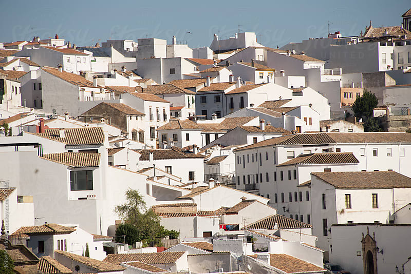 Rows of white houses in a traditional mediterranean setting. by Mike Marlowe for Stocksy United