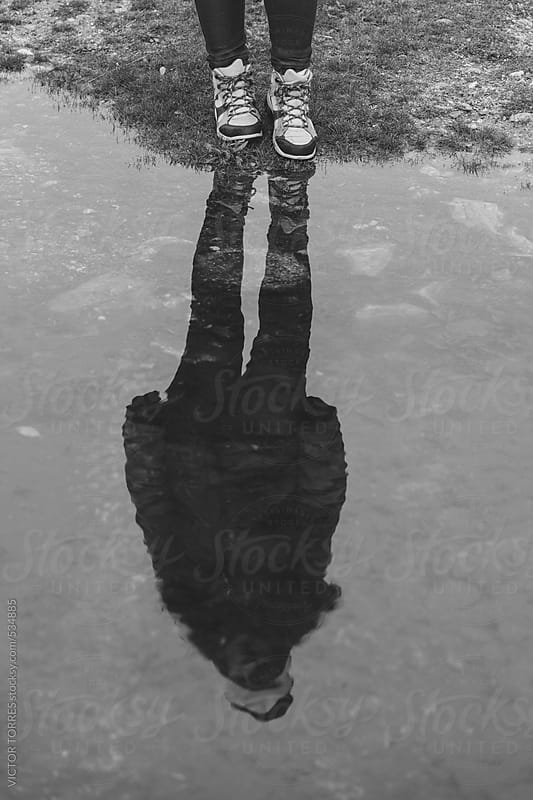 Children Reflected on a Puddle by VICTOR TORRES for Stocksy United