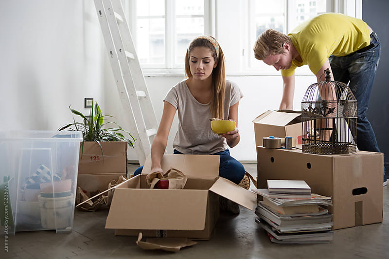 Couple Unpacking After Moving In by Lumina for Stocksy United