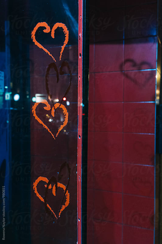 Shadow of loveheart at night on street by Rowena Naylor for Stocksy United