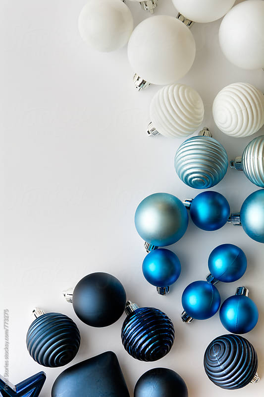 Scattered Christmas baubles on white by Pixel Stories for Stocksy United