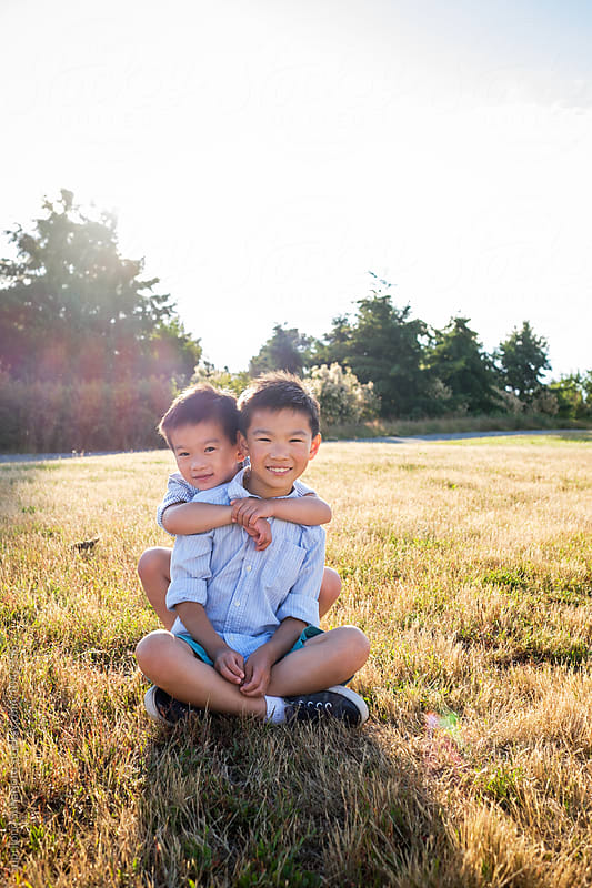 Happy Asian kids outdoor in a park by Suprijono Suharjoto for Stocksy United
