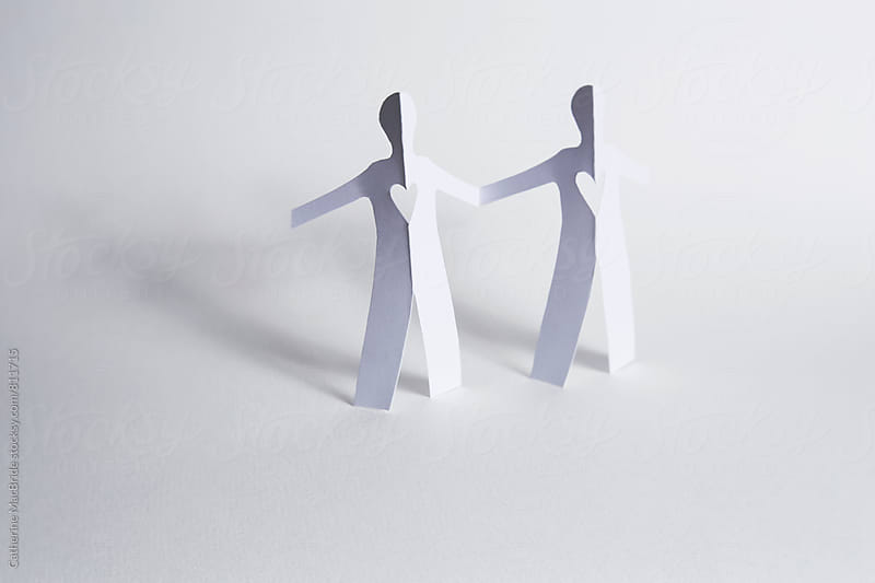 paper people holding hands... by Catherine MacBride for Stocksy United