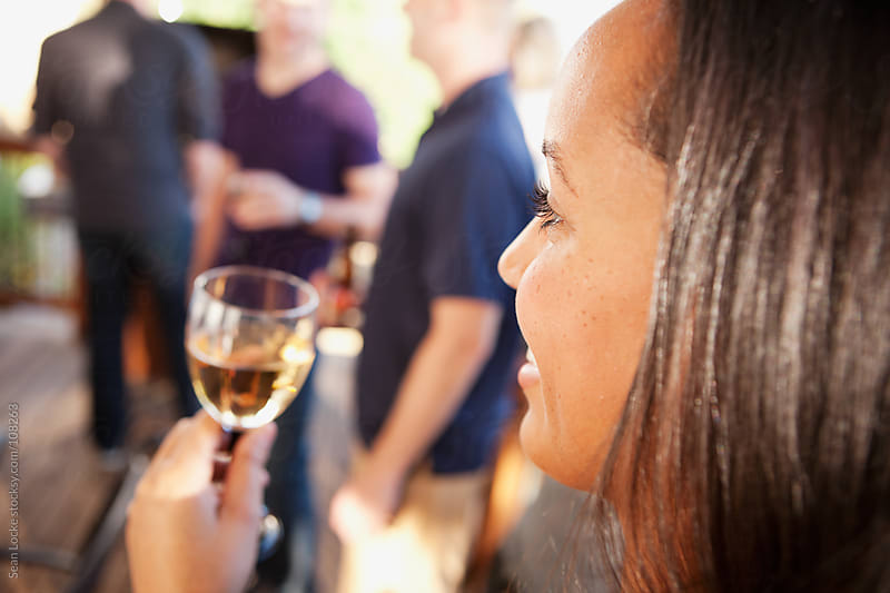 Party: Woman Drinking Wine At Party by Sean Locke for Stocksy United
