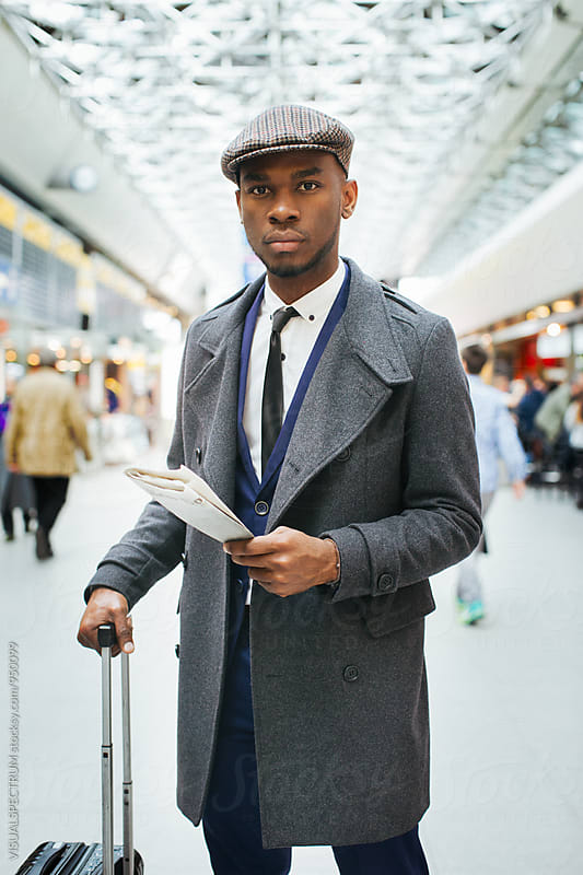 Portrait of Black Businessman in Bright Airport by VISUALSPECTRUM for Stocksy United