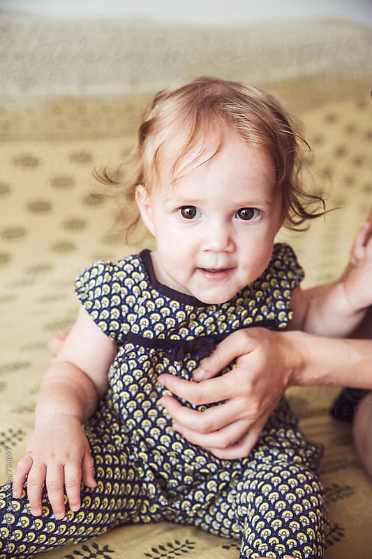 Portrait of a cute baby girl by Vera Lair for Stocksy United