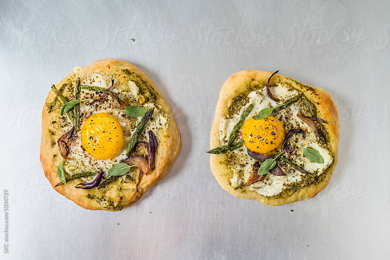 Rustic Pizzas with Egg by suzanne clements for Stocksy United