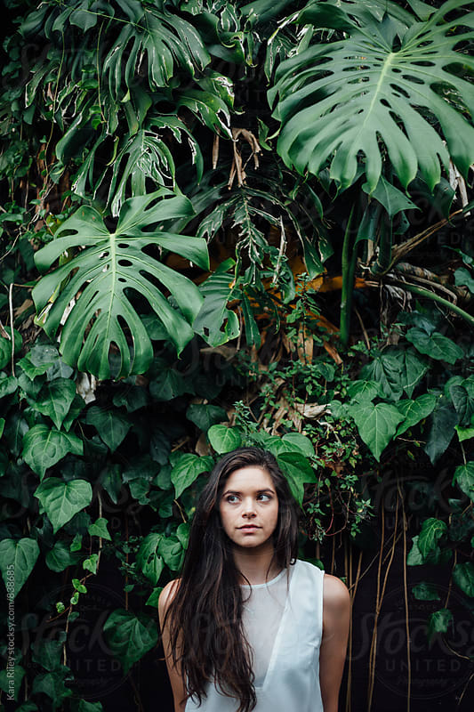 Woman in front of foliage by Kara Riley for Stocksy United