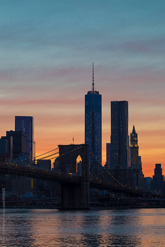 New York City - Lower Manhattan Skyline and Brooklyn Bridge against Afterglow Sky by Tom Uhlenberg for Stocksy United