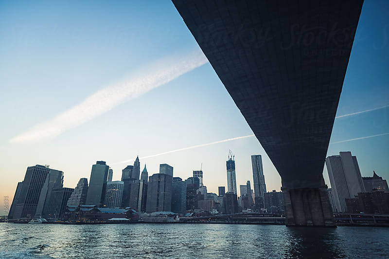 Manhattan from under Brooklyn Bridge by GIC for Stocksy United