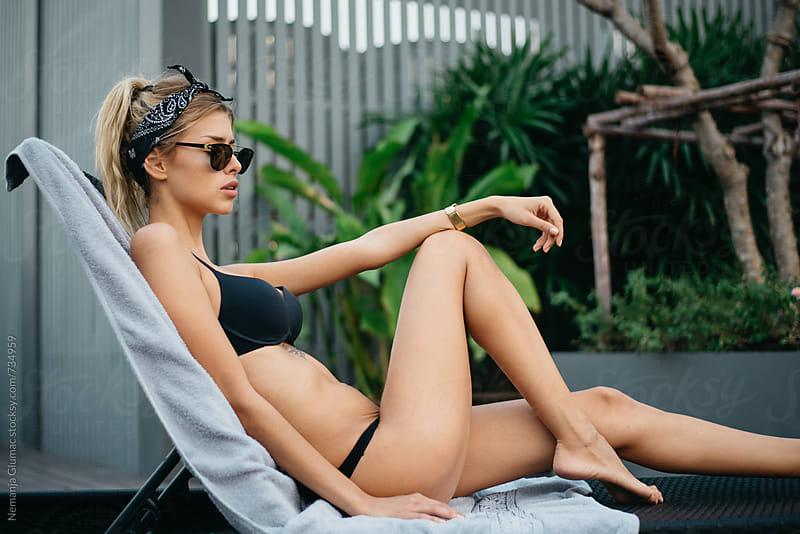 Attractive Blonde Woman Sunbathing in Black Bikini by Nemanja Glumac for Stocksy United