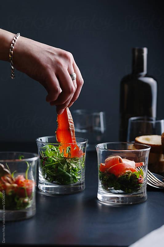 Salmon gravlax appetizer being prepared. by Darren Muir for Stocksy United