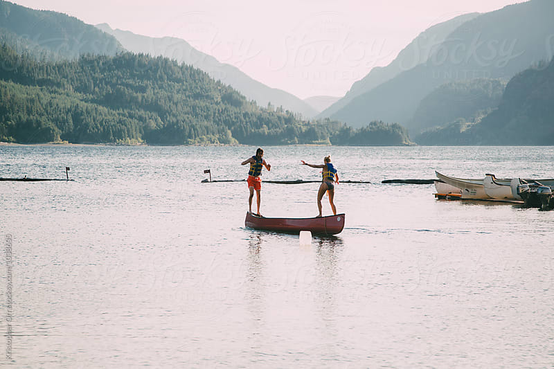 Young Adults Playing on a Canoe by Kristopher Orr for Stocksy United