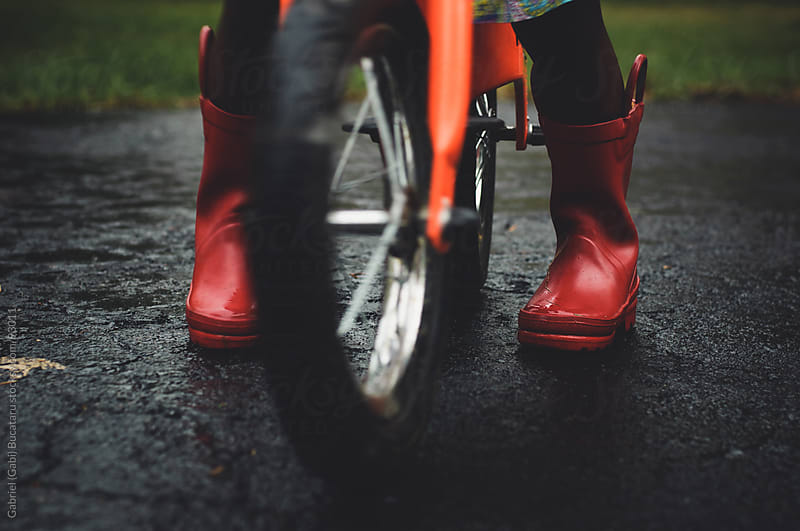 Red Rain Boots by Gabriel (Gabi) Bucataru for Stocksy United