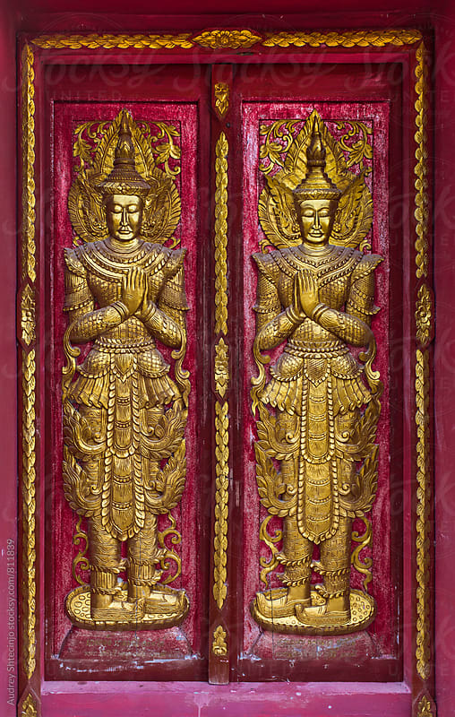 Detail on door on the buddhist temple/golden guardians by Audrey Shtecinjo for Stocksy United