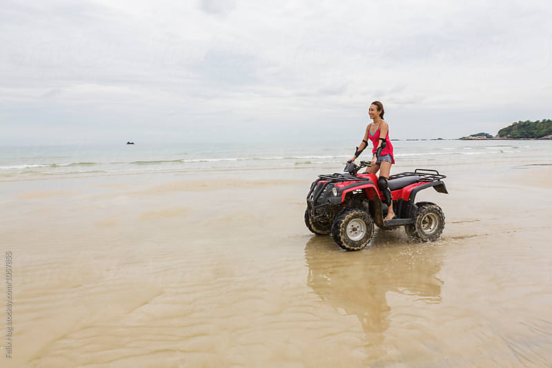 an asian woman driving an ATV