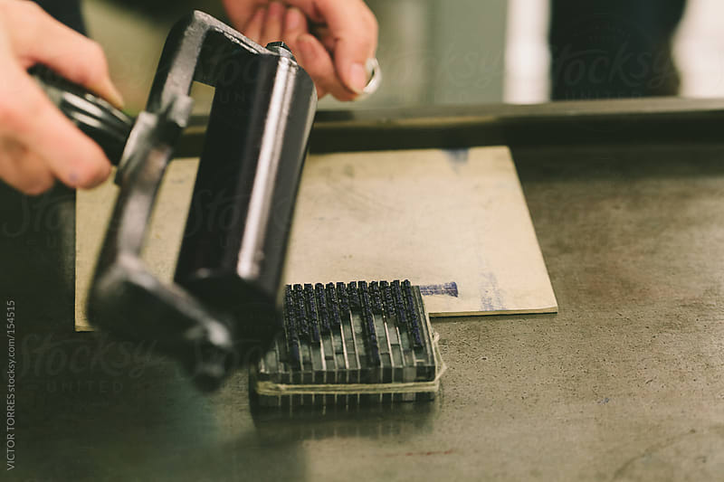 Worker Transferring Ink to a Block of Lead Types by VICTOR TORRES for Stocksy United