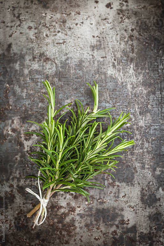 Bunch of rosemary on old rusty baking tray by Elisabeth Coelfen for Stocksy United