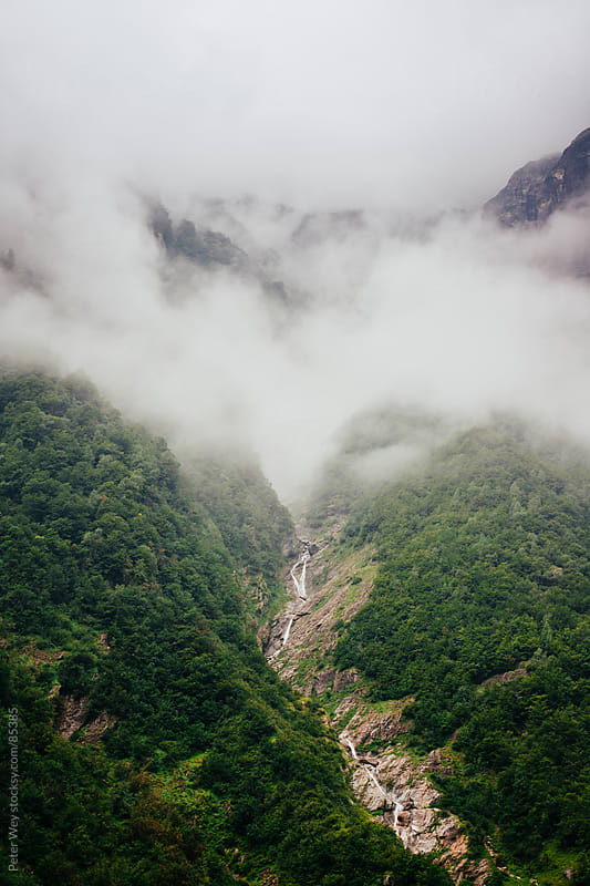Hanging clouds in the Urbachtal valley by Peter Wey for Stocksy United