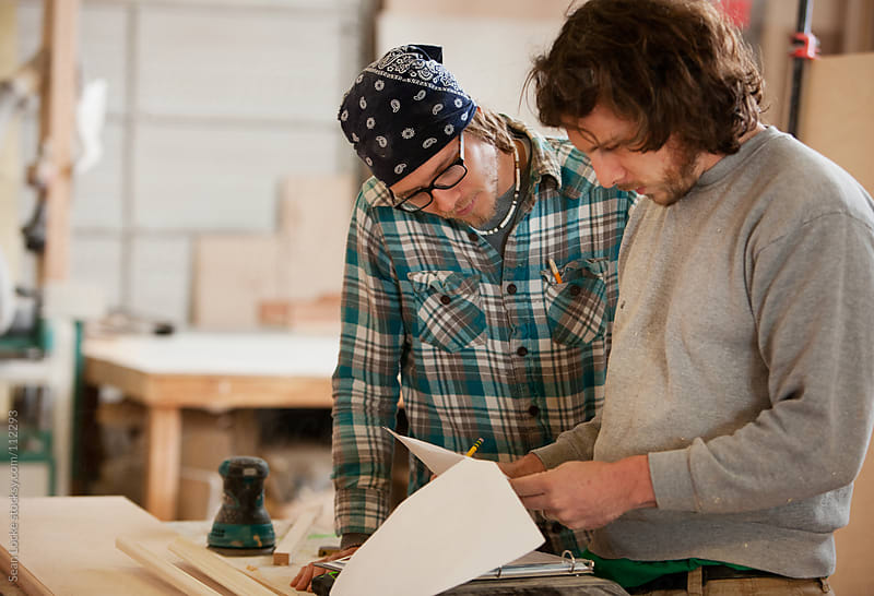 Woodworking: Co-Workers Review Plan For Project by Sean Locke for Stocksy United