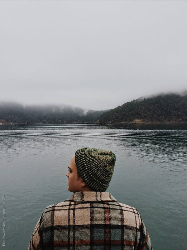 Man Observes Tide While Riding Pacific Northwest Ferry by Eric Bowley for Stocksy United