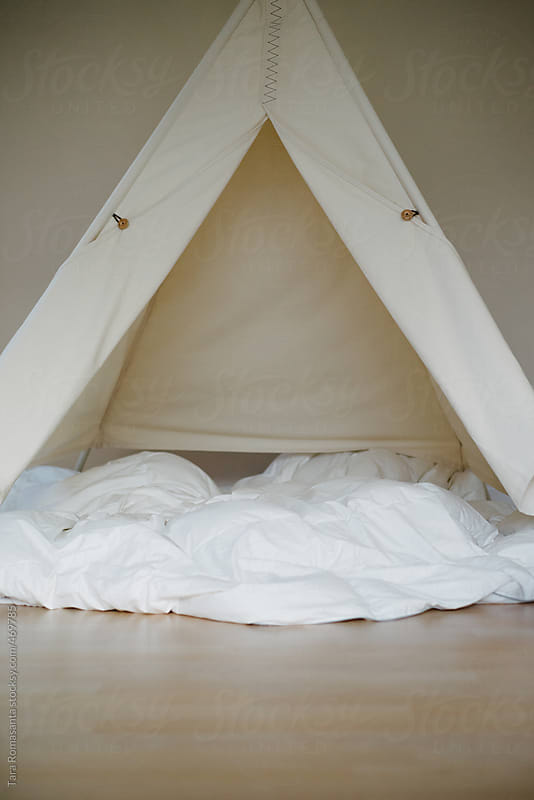 an empty cozy-looking play tent or teepee by Tara Romasanta for Stocksy United