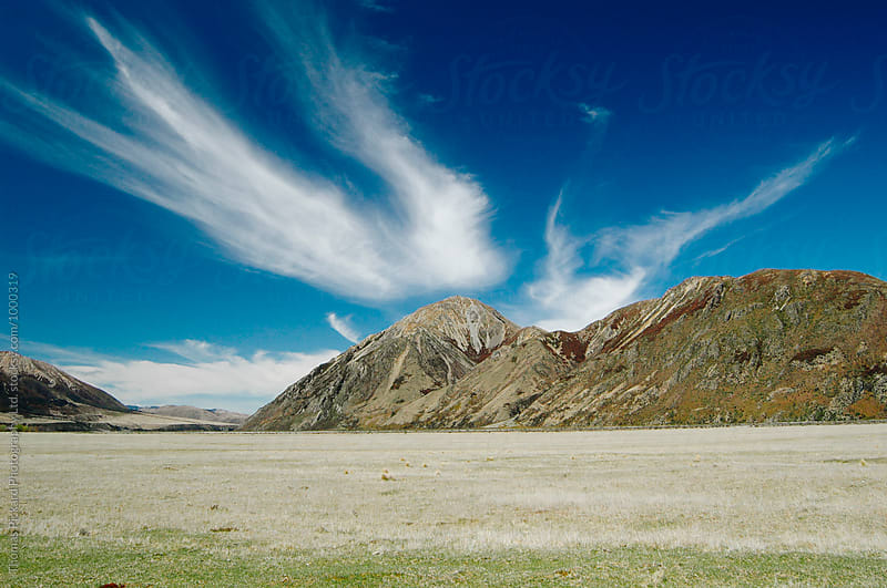 Cloud and barren mountains, Hawdon Valley, New Zealand. by Thomas Pickard Photography Ltd. for Stocksy United