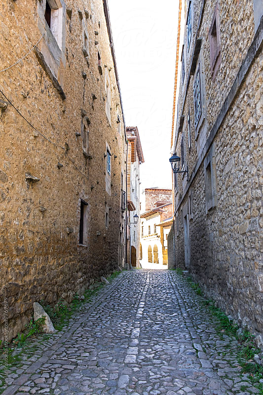 Street in the medieval town of Santillana del Mar by Marilar Irastorza for Stocksy United