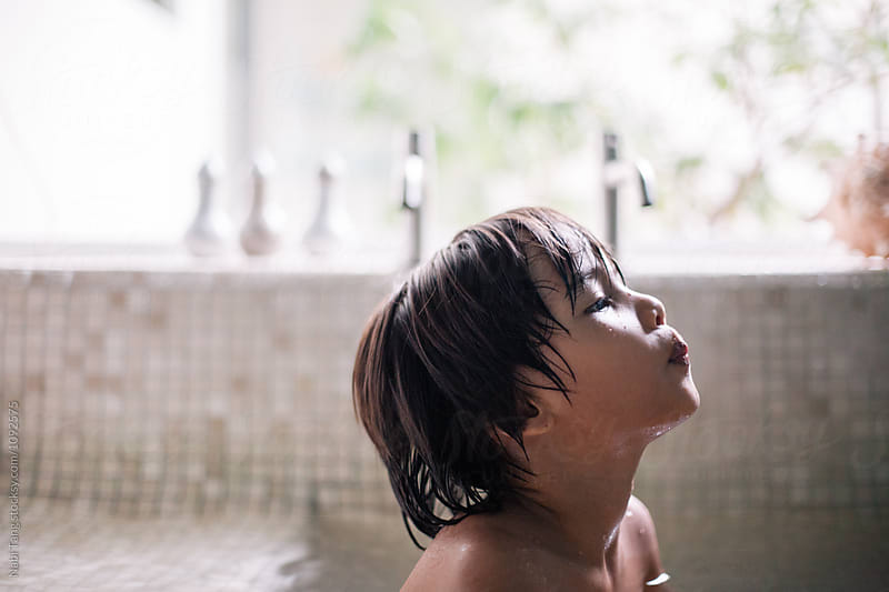 Kid in the bathtub by Nabi Tang for Stocksy United