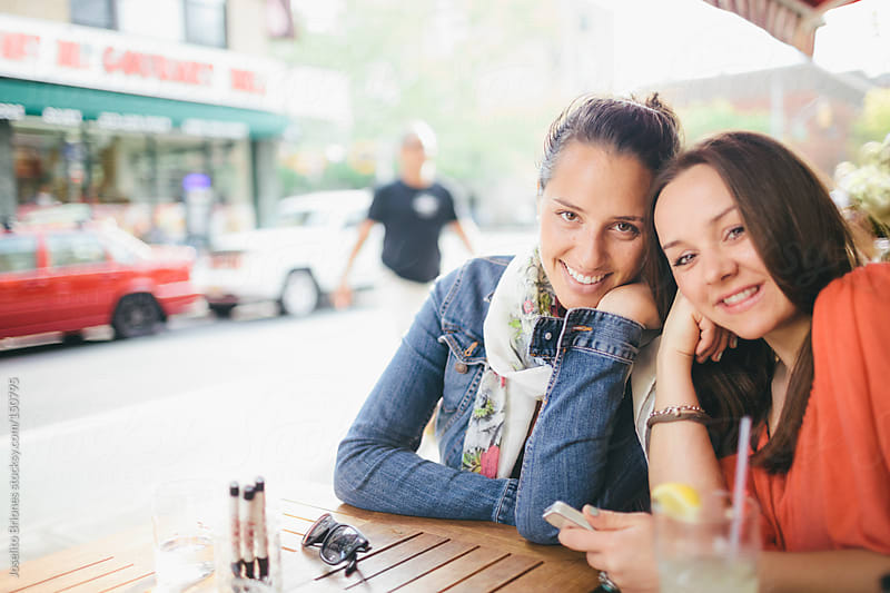 Women Best Friends Hanging Out and Having Fun at a Cafe in New York's Lower East Side by Joselito Briones for Stocksy United