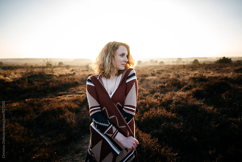 a woman standing in the heath by Christian Zielecki for Stocksy United