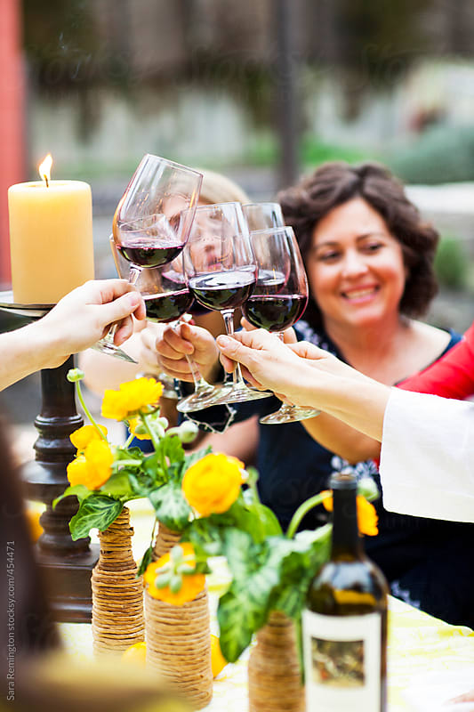 Dinner Party Cheers With Red Wine by Sara Remington for Stocksy United