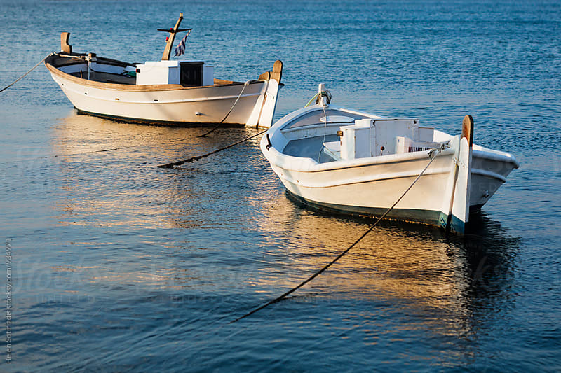 Two Fishing Boats at Sunset by Helen Sotiriadis for Stocksy United