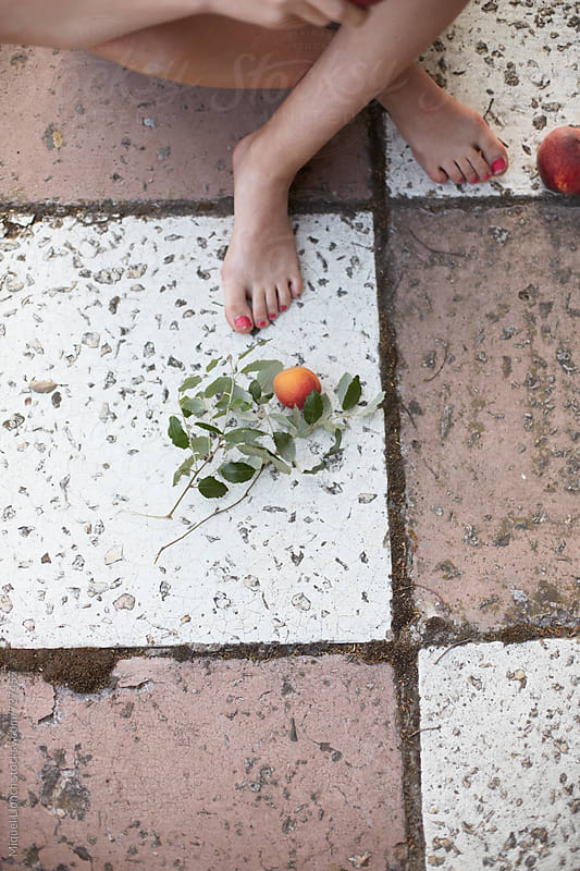 Barefoot with fruit by Miquel Llonch for Stocksy United