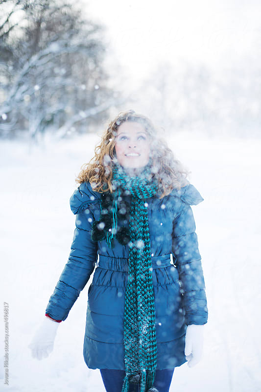 Portrait of a young happy woman in the snow by Jovana Rikalo for Stocksy United