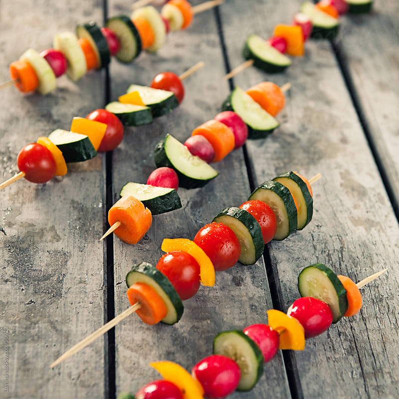 Vegetable Skewers on Wood by Lumina for Stocksy United