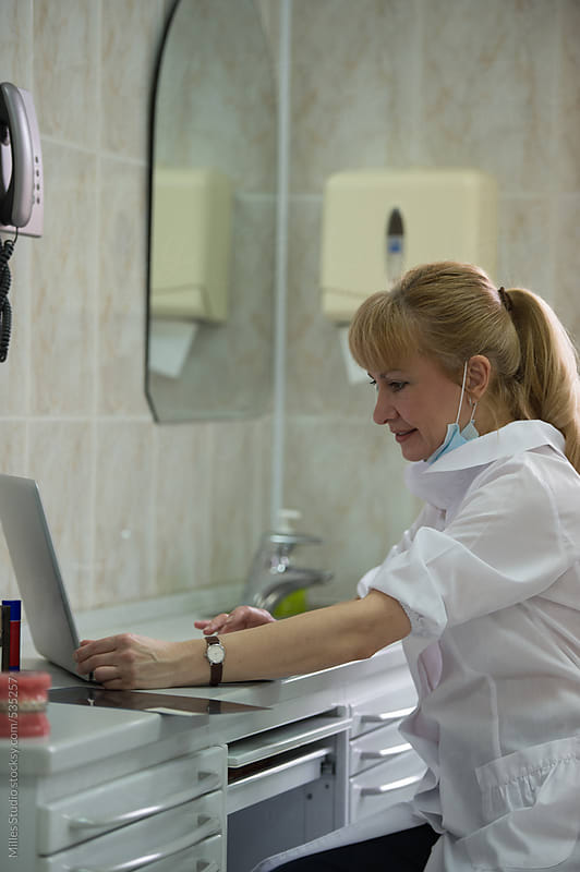 Doctor typing on her computer by Milles Studio for Stocksy United