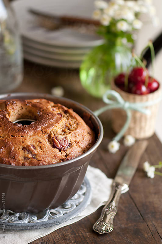cherries and yogurt cake in the mold by Laura Adani for Stocksy United