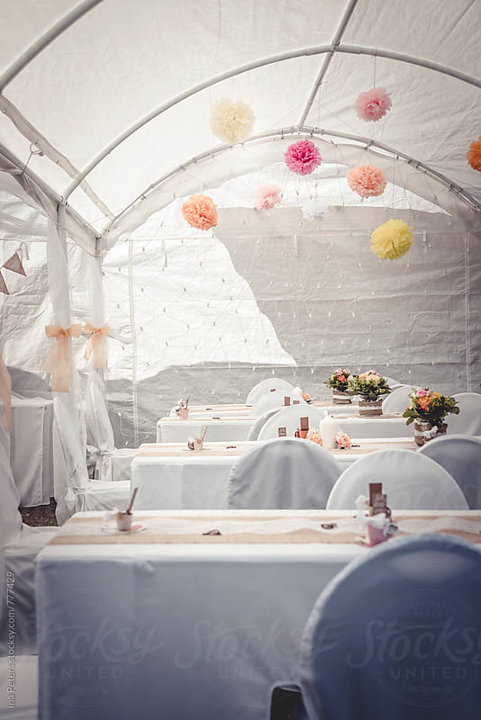 Wedding decoration with colorful pompons by Ina Peters for Stocksy United