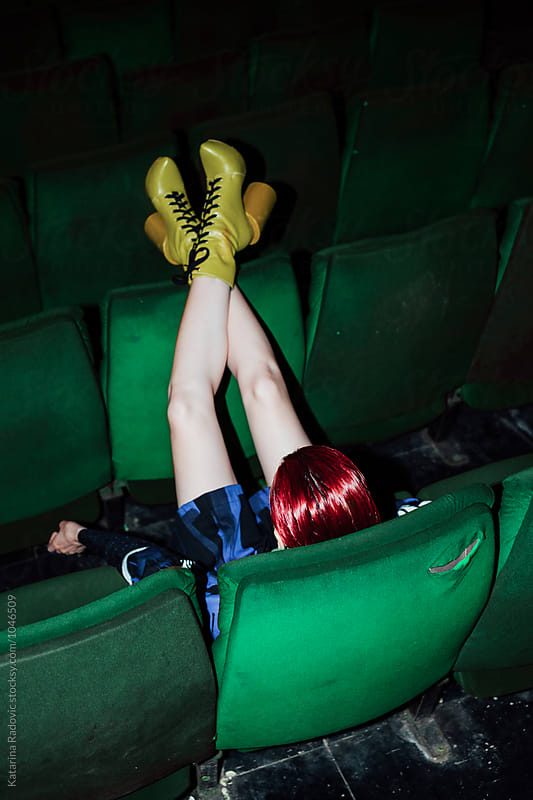 Fashion Model Sitting in the Cinema by Katarina Radovic for Stocksy United