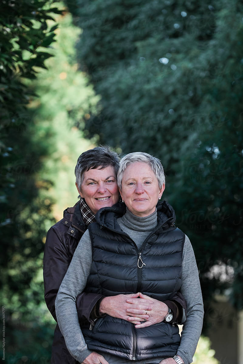 Mature Lesbian Couple Embracing  Stocksy United-3827