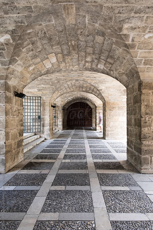 Tunnel arches of Almudaina Palace in Palma de Majorca by Marilar Irastorza for Stocksy United