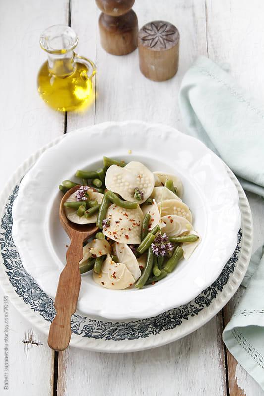 Green bean salad with pasta corzetti by Babett Lupaneszku for Stocksy United