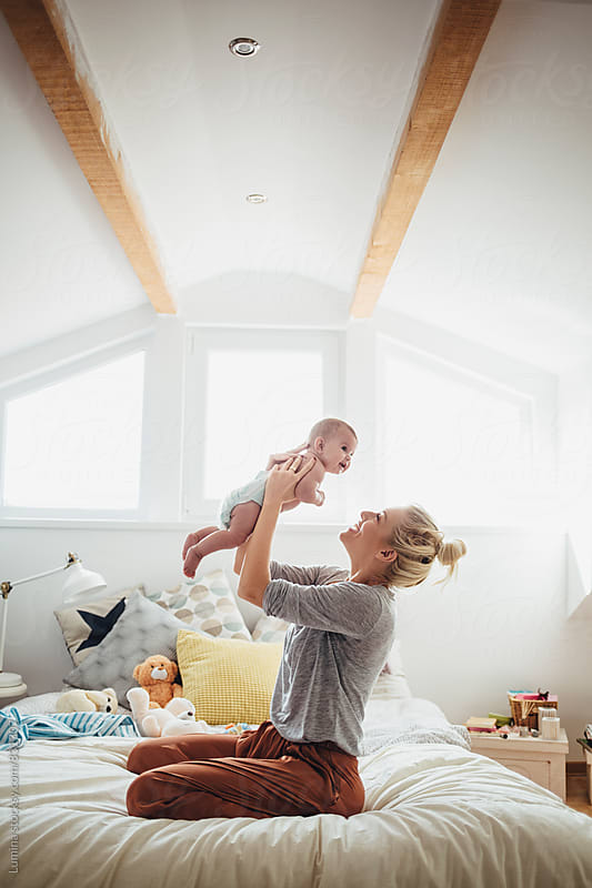 Mother Playing With Her Baby by Lumina for Stocksy United