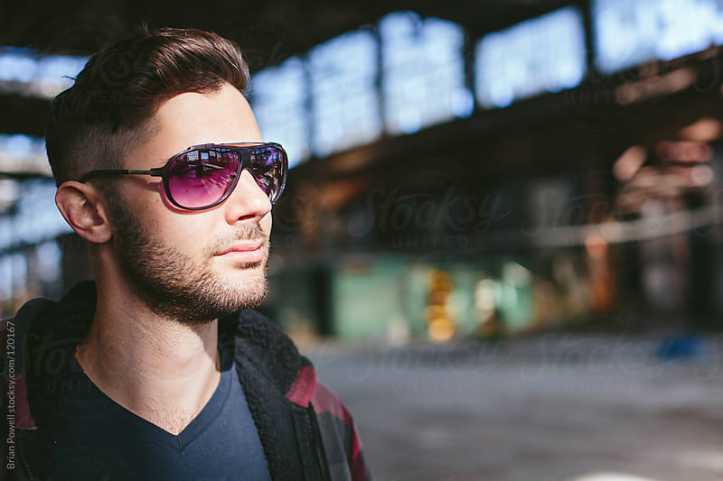 young guy wearing sunglasses by Brian Powell for Stocksy United
