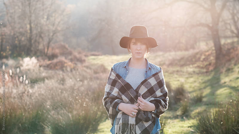 Young Woman on the Countryside by Branislav Jovanovic for Stocksy United
