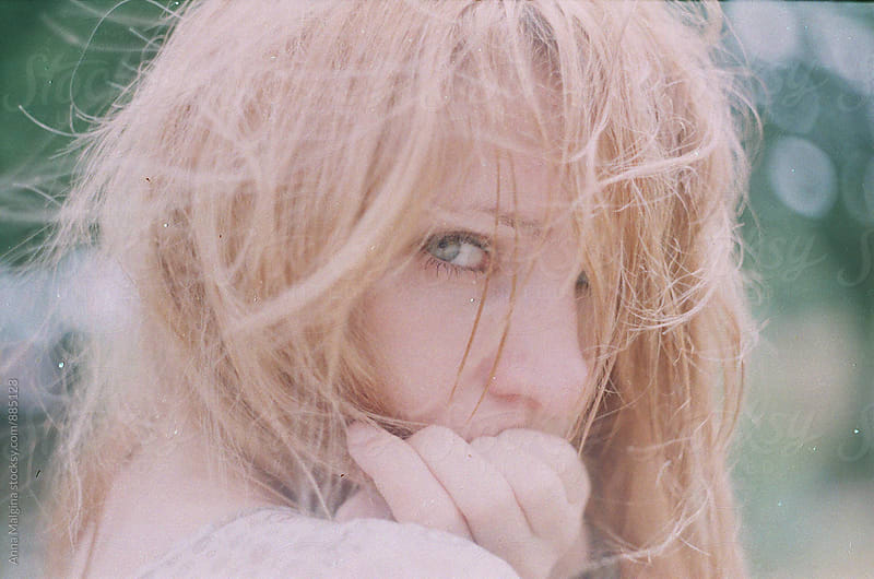 A film portrait of a young redhead woman in blur by Anna Malgina for Stocksy United